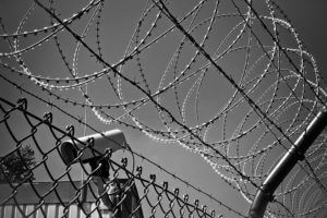 prison fences and security cameras