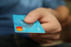 man using a debit card