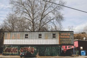 shipping containers covered in graffiti