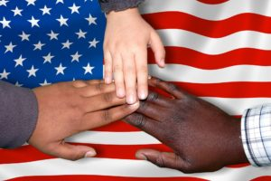diverse hands over an american flag