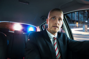 41318904 - portrait of a young scared man pulled over by police